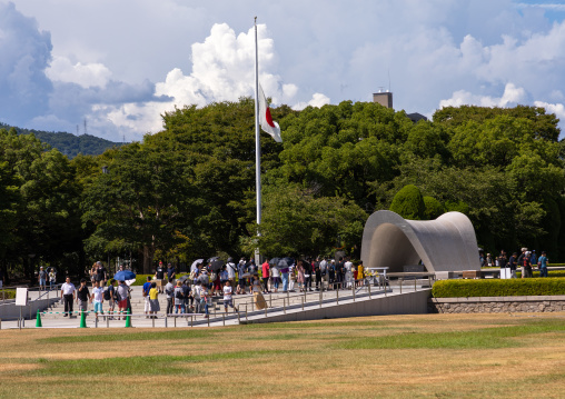 People visiting the cenotaph for a-bomb victims and a-bomb dome, Chugoku region, Hiroshima, Japan
