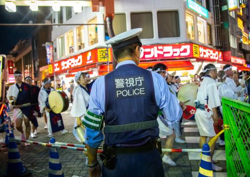 Police during the Koenji Awaodori dance summer street festival, Kanto region, Tokyo, Japan