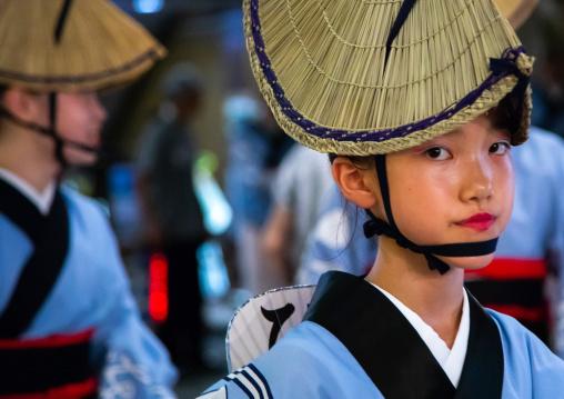 Japanese child with straw hat during the Koenji Awaodori dance summer street festival, Kanto region, Tokyo, Japan