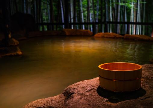 Bamboo bucket next to a forest hot spring in Takefue ryokan, Kumamoto Prefecture, Minamioguni-machi, Japan