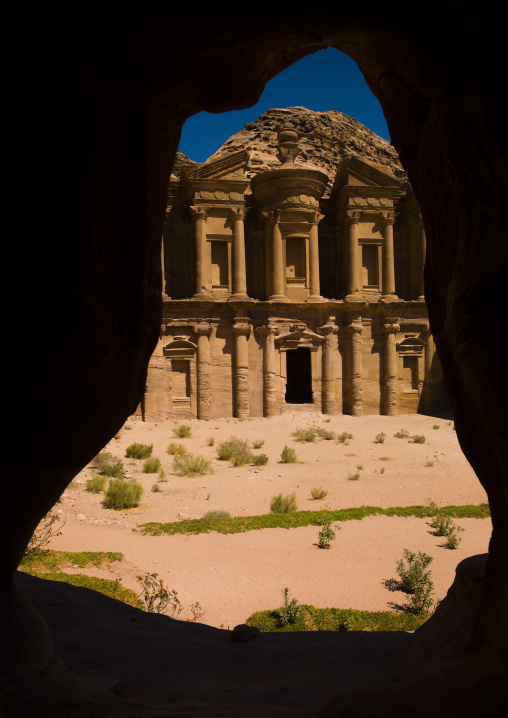 Temple Of Al Deir The Monastery View Through The Window Of A Traditional Family Cave In Petra, Jordan
