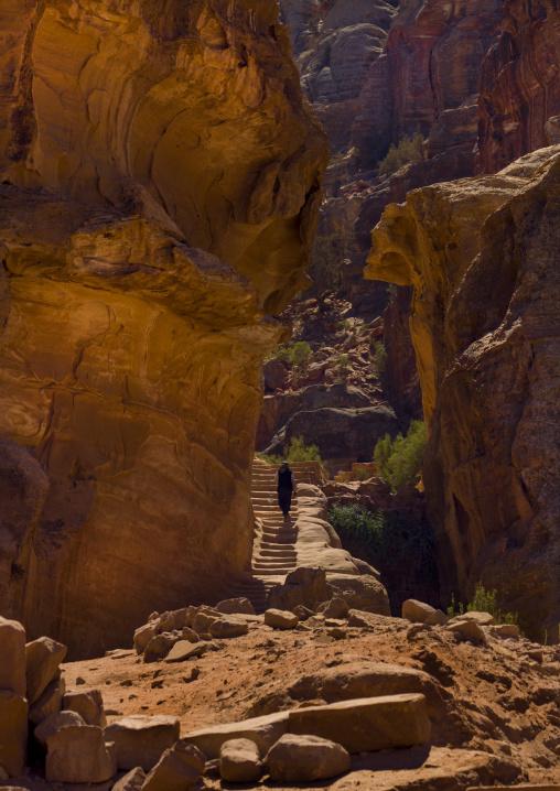 Woman Climbing Ancient Stairs In Petra, Jordan