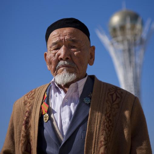 Old Veteran In Front Of Baiterek Tower, Astana, Kazakhstan