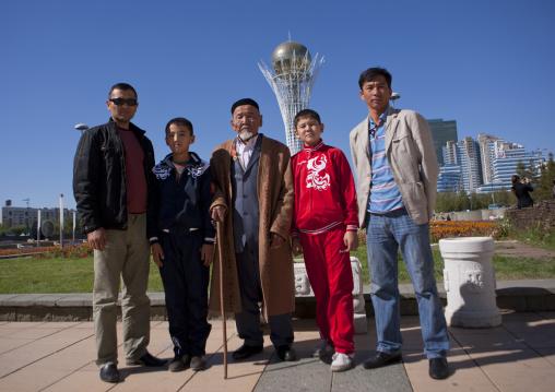 Old Veteran And His Family In Front Of Baiterek Tower, Astana, Kazakhstan