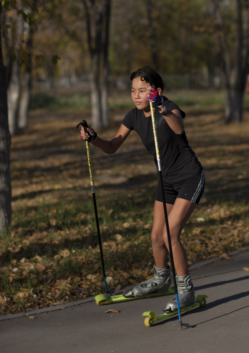 Girl Roller Skiing In Astana Park, Kazakhstan