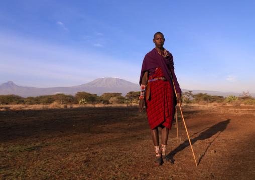 Maasai in front of kilimanjaro, Kajiado County, Amboseli park, Kenya