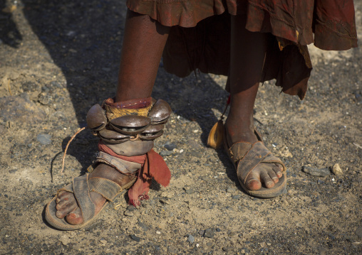 Turkana tribe woman in traditional footwear 'firestone' sandals, Turkana lake, Loiyangalani, Kenya