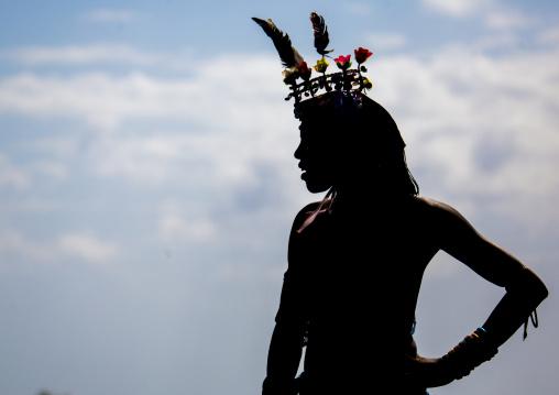 Silhouette of rendille warrior wearing traditional headwear, Turkana lake, Loiyangalani, Kenya