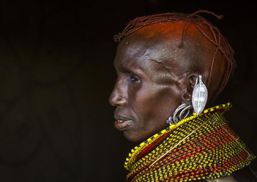 Turkana tribe woman with huge necklaces and earrings, Turkana lake, Loiyangalani, Kenya