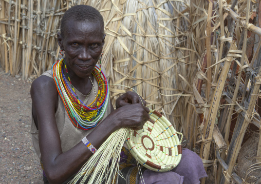 El molo tribeswoman making a basket, Turkana lake, Loiyangalani, Kenya
