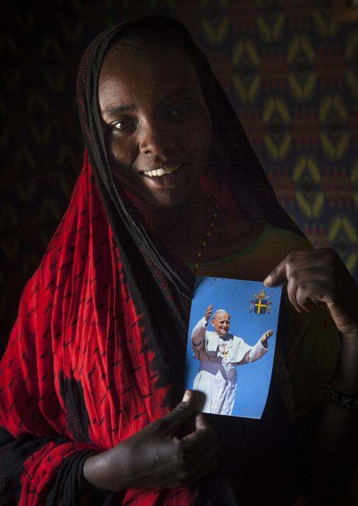Gabbra tribe woman holding a picture of pope jean paul two, Chalbi desert, Kalacha, Kenya