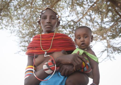Rendille tribeswoman holding her baby, Marsabit district, Ngurunit, Kenya
