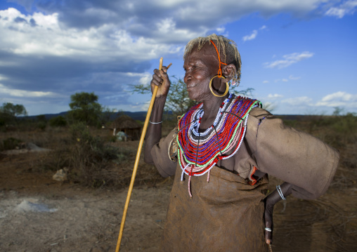 A pokot woman wears large necklaces made from the stems of sedge grass, Baringo county, Baringo, Kenya