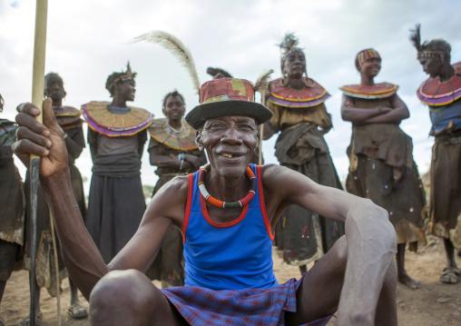 Pokot tribe people man pausing in front of the women, Baringo county, Baringo, Kenya