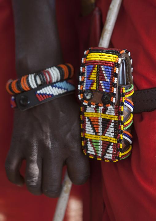 Masai warrior mobile phone decorated with beads, Nakuru county, Nakuru, Kenya