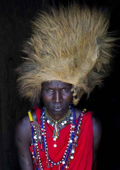 Maasai warrior with a lion hat fur on the head, Nakuru county, Nakuru, Kenya