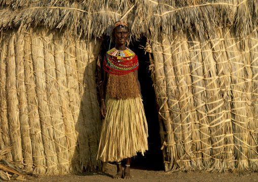 Portrait of an El Molo tribe woman standing in the entrance of her house, Rift Valley Province, Turkana lake, Kenya