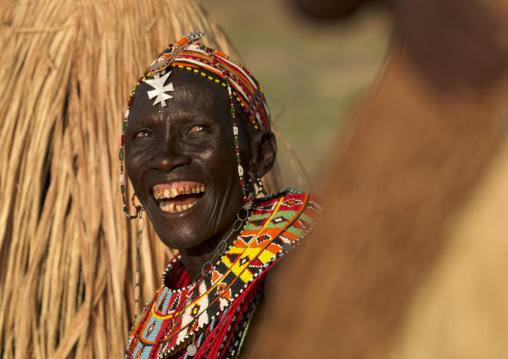 Portrait of a laughing El Molo tribe woman, Rift Valley Province, Turkana lake, Kenya