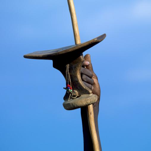 Pokot tribe man with a wooden headrest and a spear, Baringo County, Baringo, Kenya