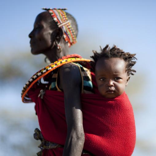 Portrait of a Samburu tribe woman with her child in the back, Samburu County, Maralal, Kenya