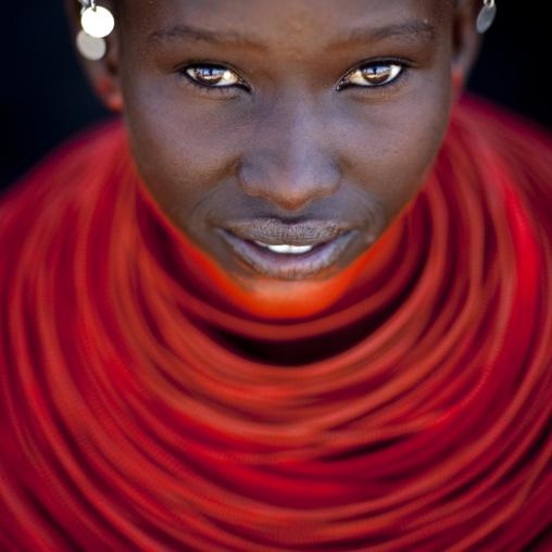 Portrait of a young Samburu tribe woman with red necklaces, Samburu County, Maralal, Kenya