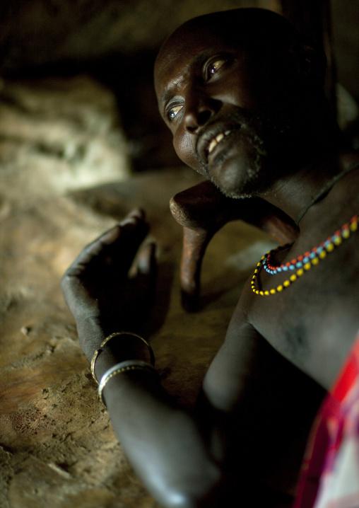 Portrait of a Samburu tribe warrior resting on his bed, Samburu County, Maralal, Kenya