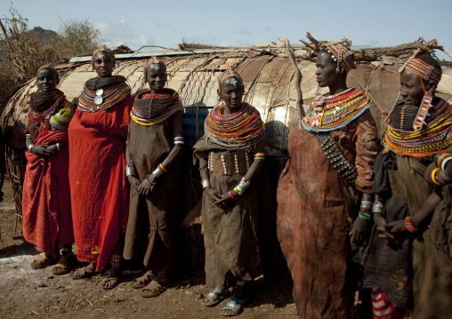 Rendille tribe women with leather skirts in front of a hut, Marsabit County, Marsabit, Kenya