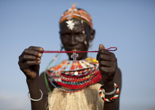 Portrait of an El Molo tribe woman showing a christian cross, Rift Valley Province, Turkana lake, Kenya