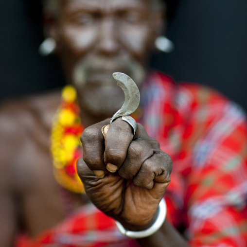 Portrait of a Turkana tribe man with a blade on his hand, Rift Valley Province, Turkana lake, Kenya