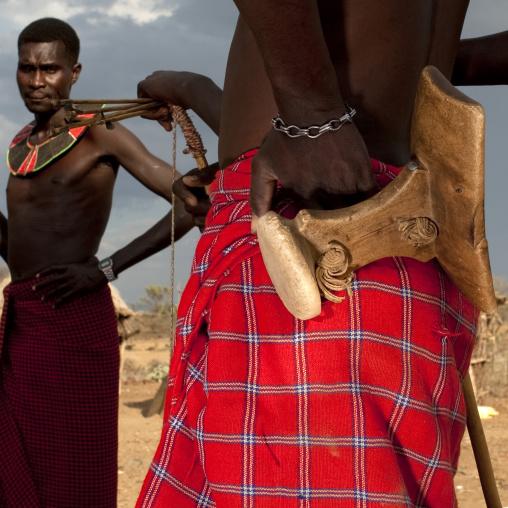 Pokot tribe men with a wooden headrest, Baringo County, Baringo, Kenya