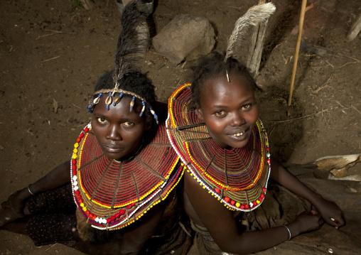 Portrait of Pokot tribe girls with huge necklaces, Baringo County, Baringo, Kenya