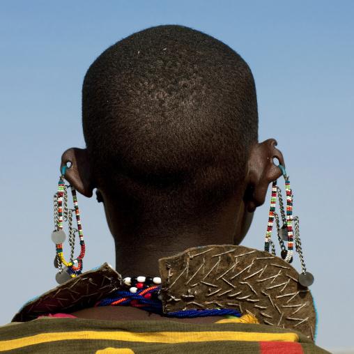 Rear view of a Maasai woman with earrings, Rift Valley Province, Maasai Mara, Kenya