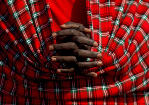 Maasai tribe man hands crossed, Rift Valley Province, Maasai Mara, Kenya