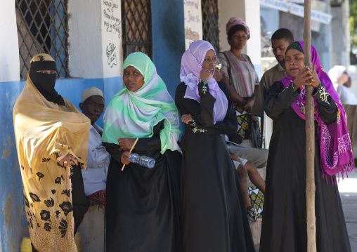 Small group of muslim women outside a house, Lamu County, Lamu, Kenya