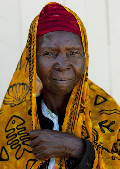 Swahili woman wearing yellow veil, Lamu County, Lamu, Kenya