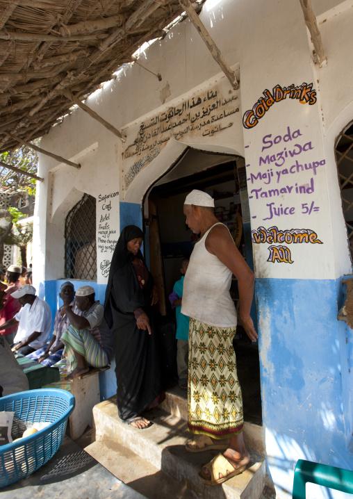 Muslim people at the entrance of a shop, Lamu County, Lamu, Kenya