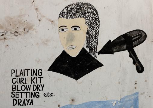Hairdresser painted sign on a wall, Lamu County, Lamu, Kenya