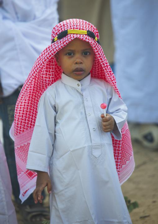 Young muslim boy during Maulid festival, Lamu County, Lamu, Kenya