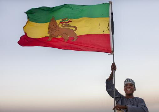 Teenage muslim boy holding an ethiopian flag, Lamu County, Lamu, Kenya