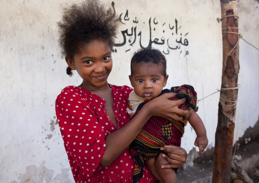 Young girl with baby boy, Lamu County, Lamu, Kenya