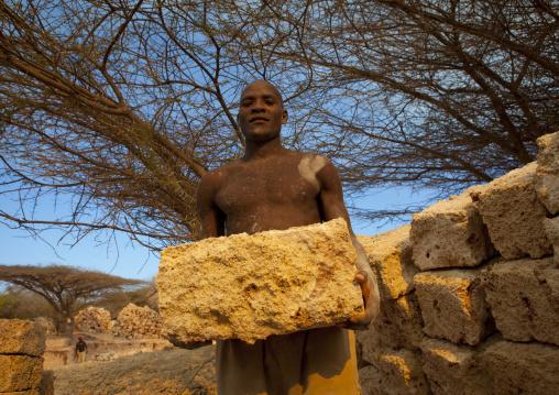 Man working in the coral stone quarry on Manda island, Lamu County, Lamu, Kenya