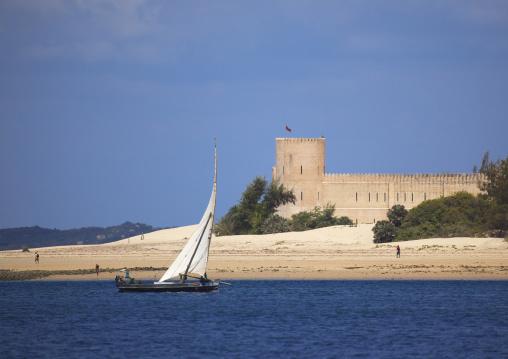 Dhow sailing along the coast in front of Fort hotel, Lamu County, Shela, Kenya