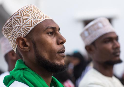Sunni muslim men celebrating the maulidi festivities in the street, Lamu county, Lamu town, Kenya