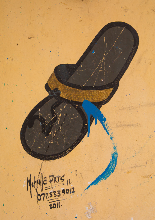 A painted sign advertising for a shoes shop, Lamu county, Lamu town, Kenya