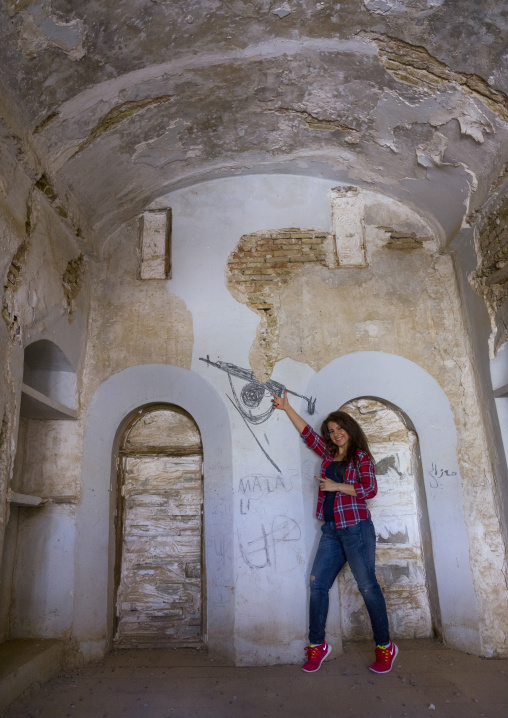 Woman Inside An Old House In The Erbil Citadel Playing With A Drawn Kalashnikov, Kurdistan, Iraq
