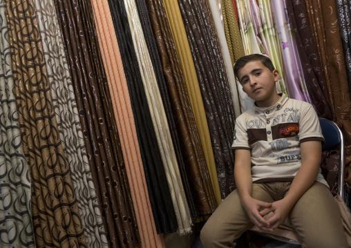 Young Boy Selling Clothes In Qaysari Bazaar, Erbil, Kurdistan, Iraq