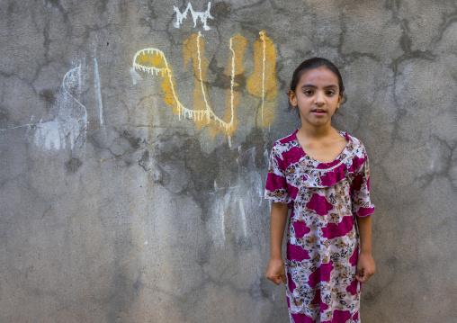 Young Syrian Refugee Girl In Front Of A Allah Graffiti, Koya, Kurdistan, Iraq