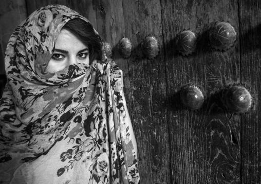 Woman With Beautiful Eyes Hidding Behind A Veil In Front Of An Old Wooden Door, Koya, Kurdistan, Iraq
