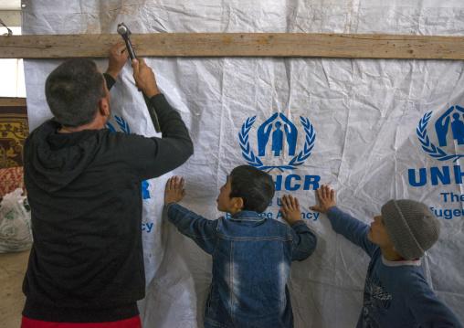 Yazidi Refugees From Sinjar Building A Shelter In An Under Construction Building, Duhok, Kurdistan, Iraq
