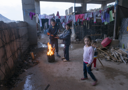 Yazidi Refugees Children Displaced From Sinjar Making Fire In An Under Construction Building, Duhok, Kurdistan, Iraq